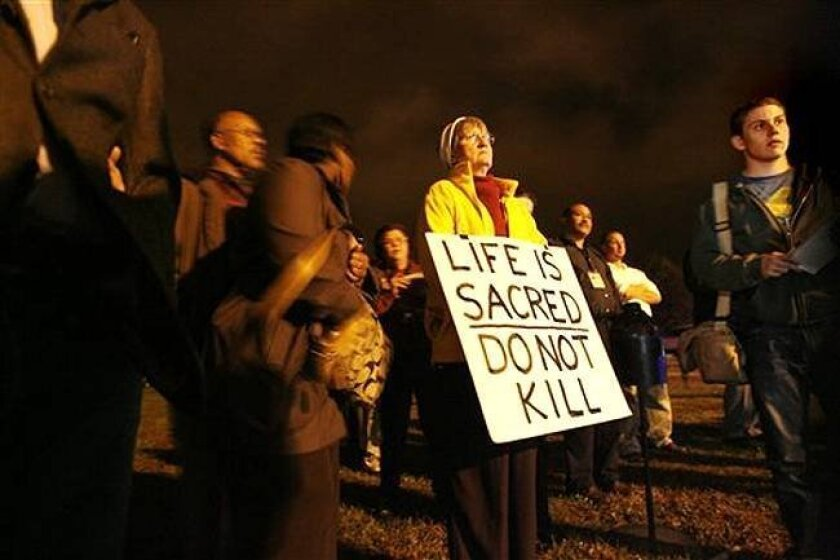 Capital punishment opponents protest outside Greenville Correctional Center in Jarratt, Va., just before the execution of D.C.-area sniper John Muhammad on Tuesday, Nov. 10.