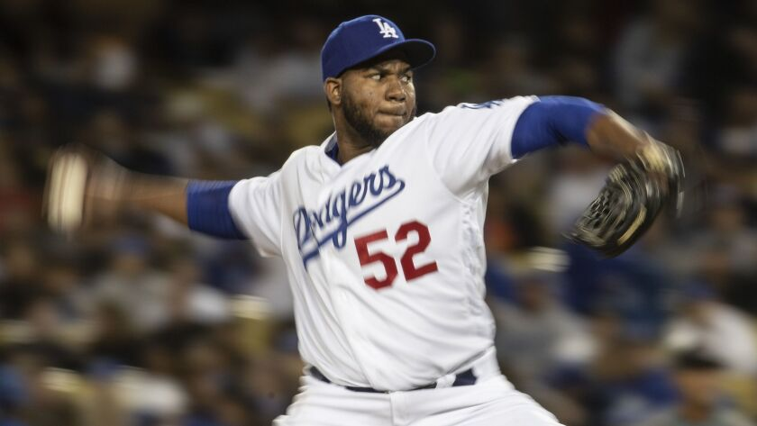Dodgers pitcher Pedro Baez delivers during the seventh inning of a 5-4 loss to the Arizona Diamondbacks.