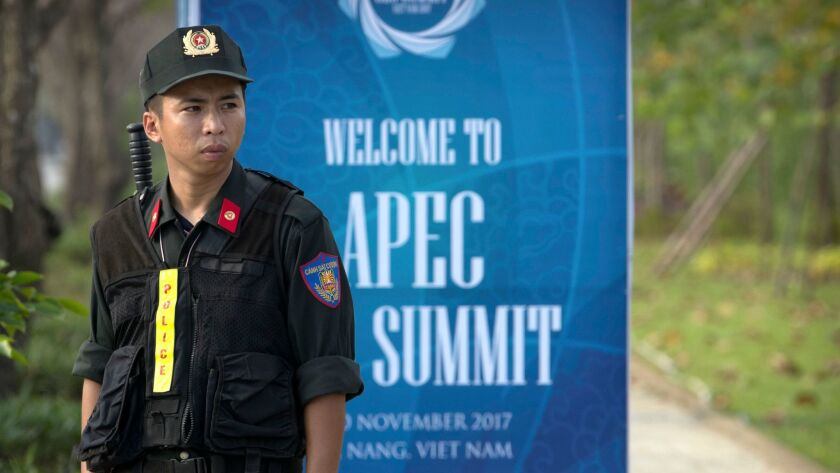A Vietnamese security official stands on guard near the venue for the Asia-Pacific Economic Cooperat