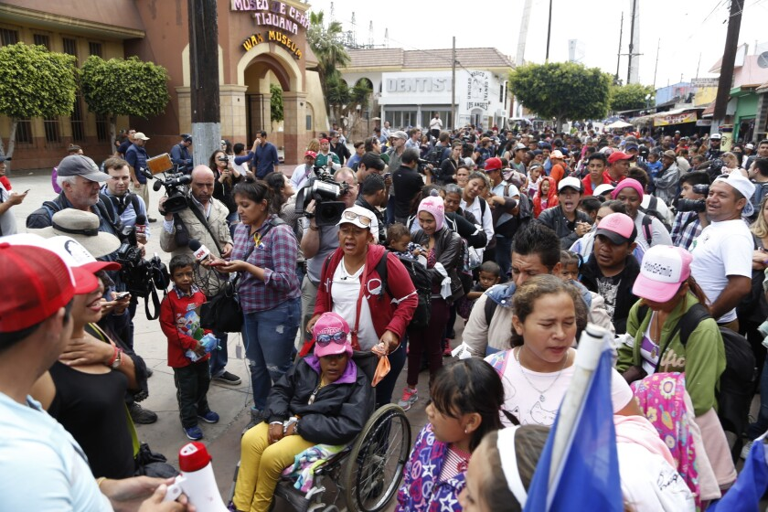 A caravan of Central America migrants and their supporters march from downtown Tijuana toward the Chaparral USA/Mexico pedestrian border in this 2018 photo. Such caravans are far less common now.
