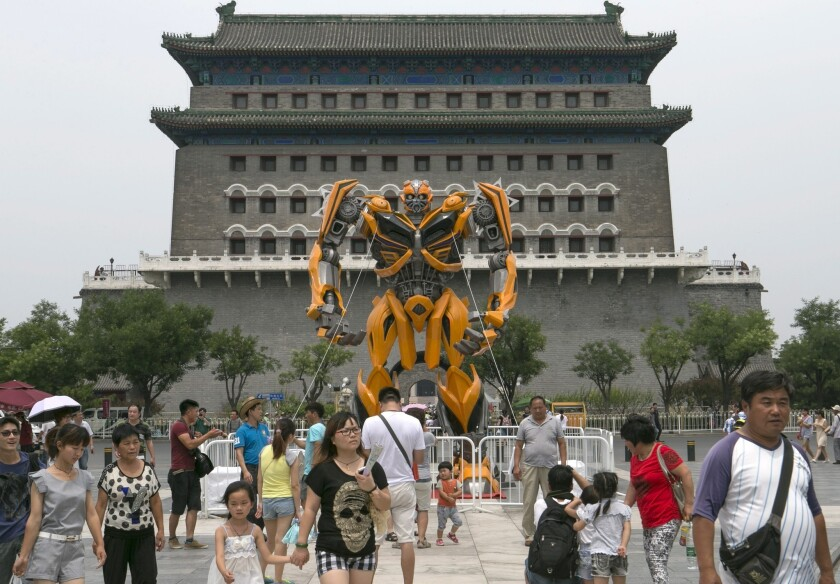 A replica of the Transformer character Bumblebee is displayed near the Qianmen district in Beijing on June 24.