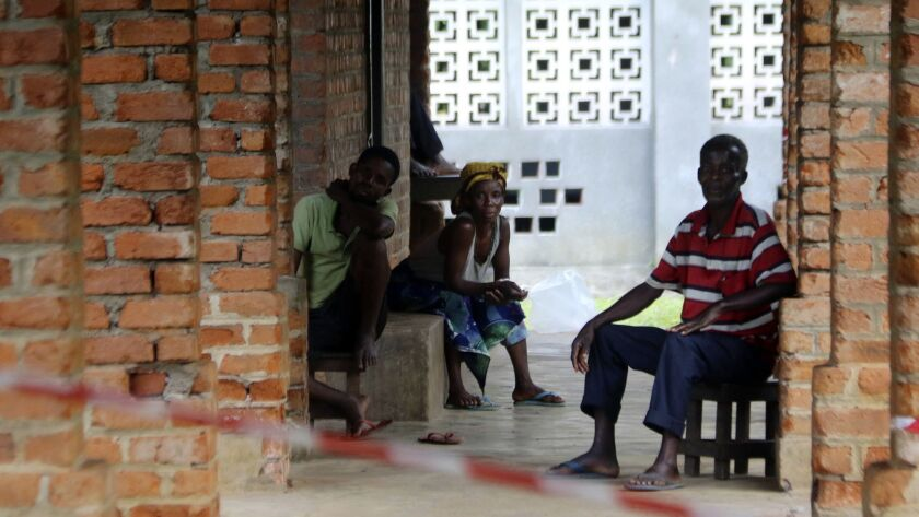 In this photo taken on Sunday, May 13, 2018, people suspected of having the Ebola Virus wait at a tr