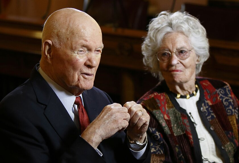 FILE - In this May 14, 2015, file photo, former astronaut and senator John Glenn and his wife Annie Glenn answer questions during an exclusive interview with The Associated Press at the Ohio Statehouse in Columbus, Ohio. On Wednesday, Feb. 17, 2016, which is Annie Glenn's 96th birthday, lawmakers i