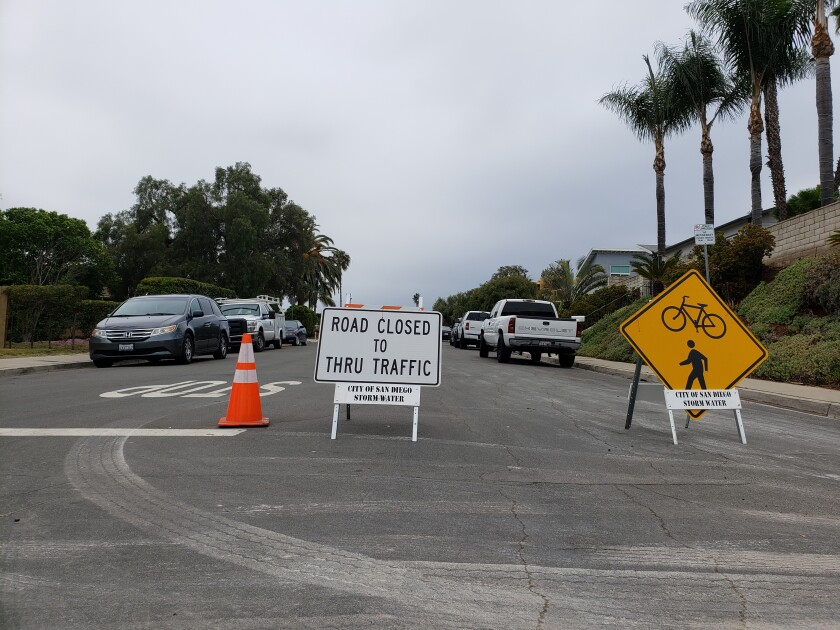 "A sign marks the ""slow street"" along Diamond Street in Pacific Beach."