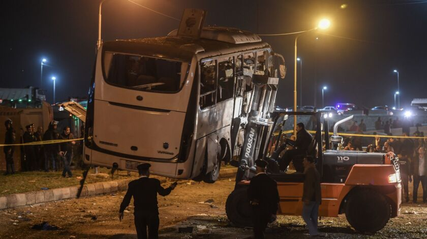 This picture taken Friday shows a tourist bus that was attacked being towed away from the scene in Giza province south of the Egyptian capital, Cairo.