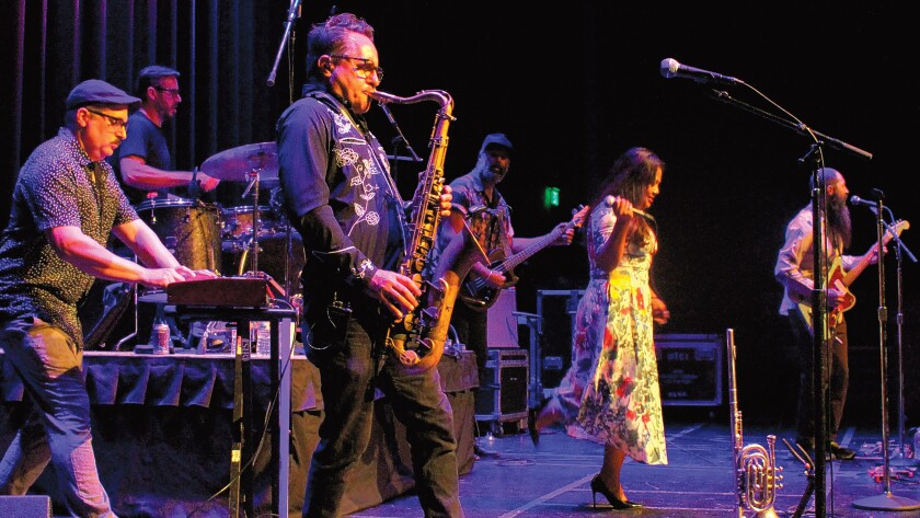 The Cambodian-American rock band, Dengue Fever, performs at an ArtPower concert.