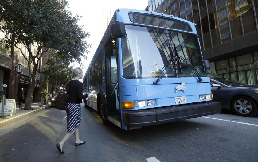 A woman boards a Leap bus in San Francisco on April 14.