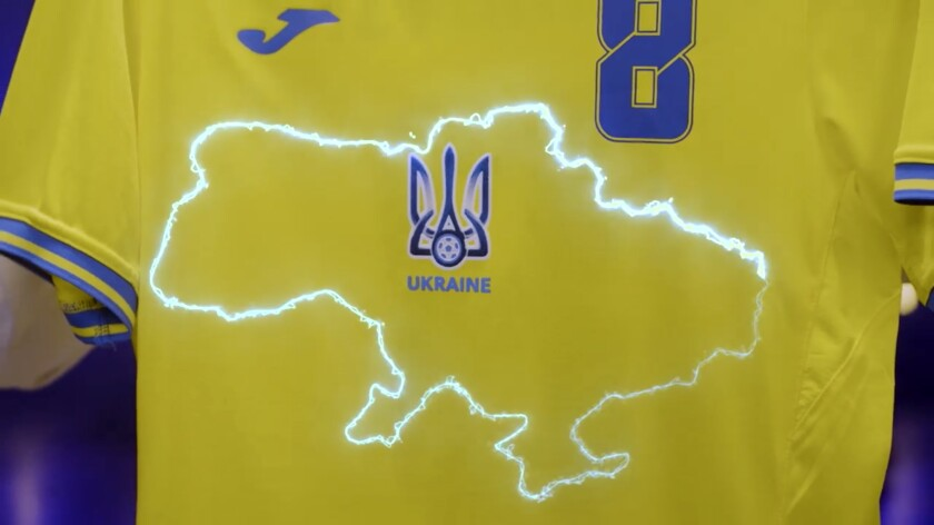 This handout photo taken from a video released by President of Ukrainian Association of Football Andrii Pavel Pavelko via Facebook, shows a new Ukraine's uniform for Ukrainian national soccer team that lights showing a map of Ukraine including Russian-annexed Crimea, Ukraine, Monday, June 7, 2021. Russian officials and lawmakers have denounced the design of the Ukrainian national soccer team's shirt for this month's European Championship. The yellow-and-blue Ukrainian uniform features a map of the country that includes Crimea. The Black Sea peninsula was annexed by Russia in 2014 following the ouster of its Moscow-friendly president. Most of the world hasn't acknowledged the annexation. (President of Ukrainian Association of Football Andrii Pavel Pavelko's Facebook account via AP)