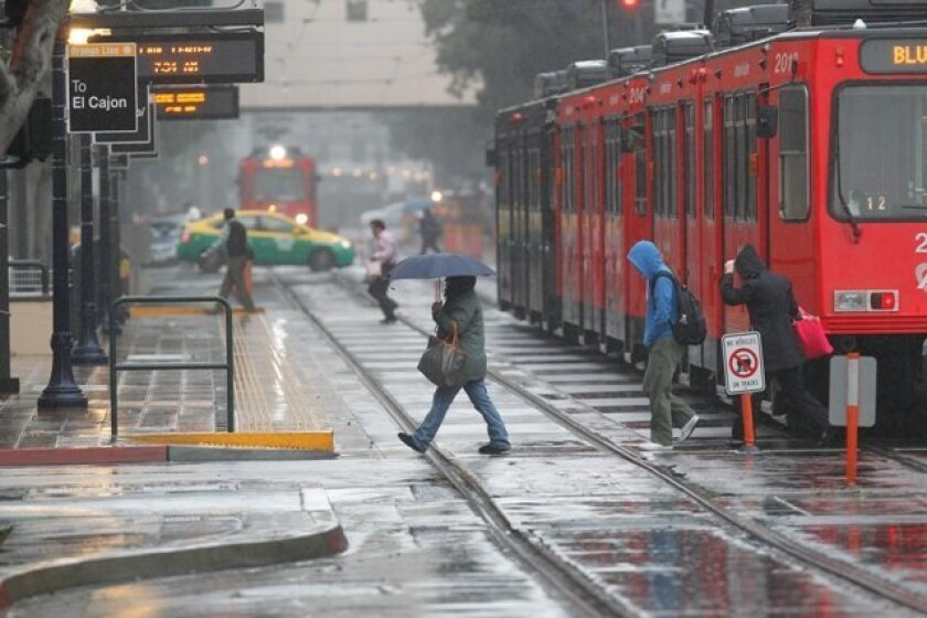 Morning commuters at the Trolley line at C Street downtown.