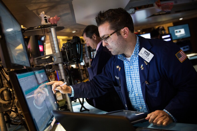 Two weeks ago when the S&P 500 crossed 2,000 for the first time, you would have notched a 148% gain if you had bought stocks on the day of President Obama's inauguration. Above, the New York Stock Exchange last week.
