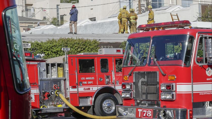 Los Angeles Fire Departments arson investigators at the recording studio fire in which two people lost three lives and two were seriously injured.