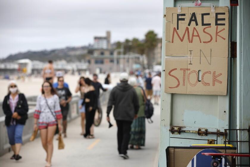 A souvenir shop offered masks for sale along the Pacific Beach boardwalk on June 24, 2020.
