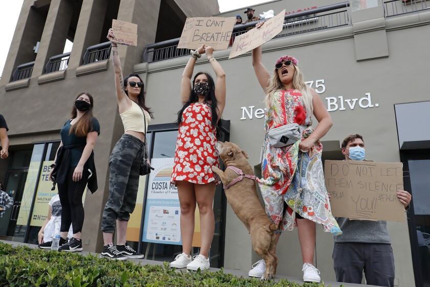 Demonstrators voice their support for the Black Lives Matter movement during a peaceful protest
