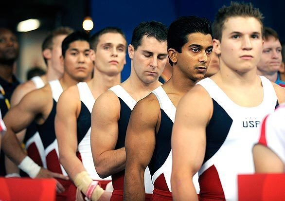 U.S. gymnasts put their game faces on before the start of the team qualifying competition in the 2008 Beijing Olympics on Saturday.