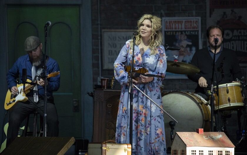 FILE - In this Saturday, June 22, 2019 file photo, Alison Krauss performs at the Outlaw Music Festival at KeyBank Pavilion in Burgettstown, Pa., a suburb of Pittsburgh. Krauss will be inducted into the Bluegrass Music Hall of Fame in September 2021, in recognition of her career as one of the genre's most acclaimed and widely known stars. (Jessie Wardarski/Pittsburgh Post-Gazette via AP)