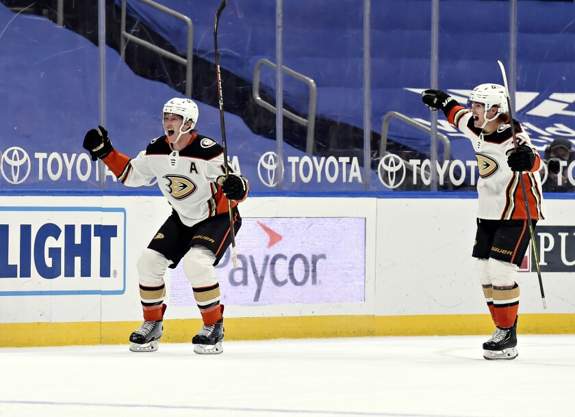 Anaheim Ducks' Josh Manson (42) reacts after scoring the game winning goal against the St. Louis Blues.