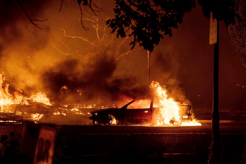 Fires rage in the central Oregon town of Talent, near Medford, late Tuesday.