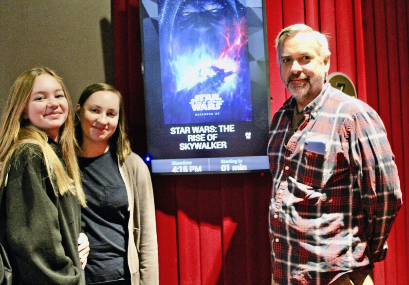 "At the Studio Movie Grill, Glendale residents, from left, Elena NyBlom, 18, sister Vanessa, 16, and father Steve NyBlom are super ""Star Wars"" fans."