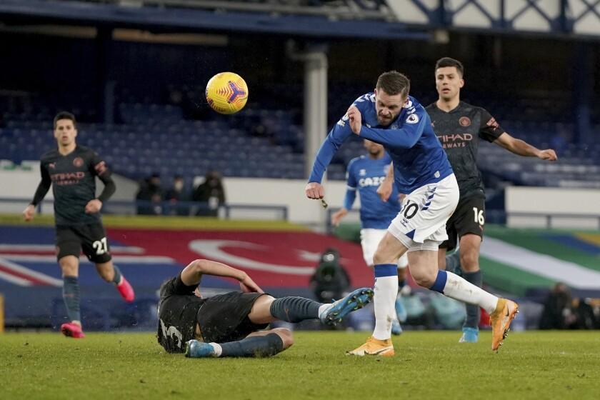 Everton's Gylfi Sigurdsson has a shot on goal blocked by Manchester City's Ruben Dias.