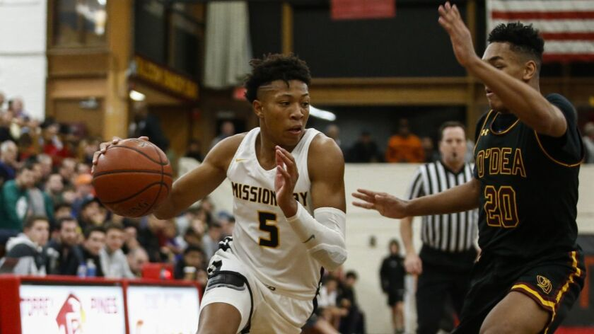 Mission Bay senior Boogie Ellis, who has signed with Duke, drives for two of his 43 points on Friday night.