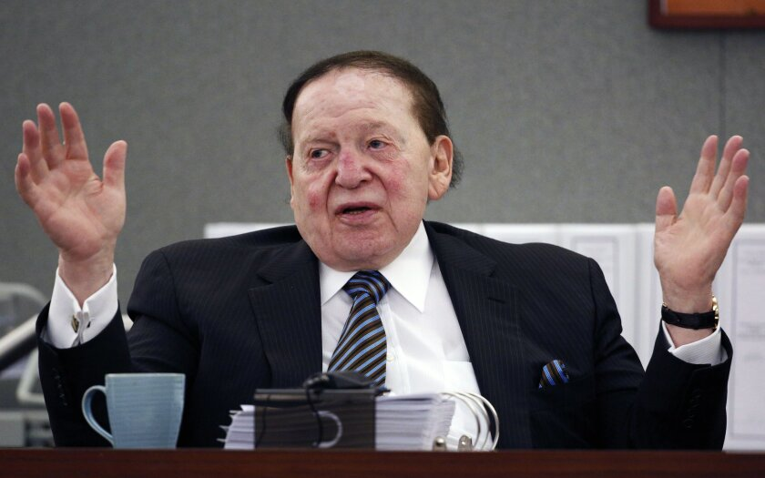 FILE - In this May 5, 2015, file photo, Las Vegas Sands Corp. Chairman and CEO Sheldon Adelson testifies in court in Las Vegas. The company owned by Adelson lost a bid to oust the Nevada judge handling a years-long legal fight by a former Macau casino executive who claims wrongful termination. A ru