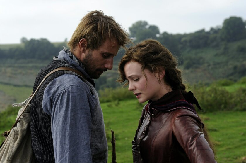 """In this image released by Twentieth Century Fox, Carey Mulligan, right, and Matthias Schoenaerts appear in a scene from """"Far From the Maddening Crowd."""" (Alex Bailey/Twentieth Century Fox via AP)"""