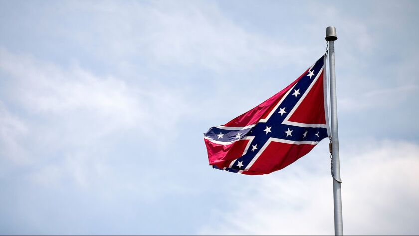 A Confederate flag flies at the base of Stone Mountain Tuesday, June 30, 2015, in Stone Mountain, Ga