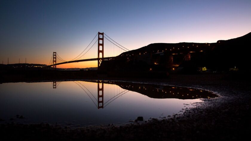 SAN FRANCISCO, CALIF. -- WEDNESDAY, NOVEMBER 11, 2015: The Golden Gate Bridge is reflected in a pudd