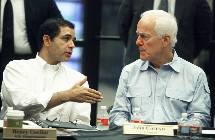 Sen. John Cornyn, right, and Rep. Henry Cuellar discuss the Helping Unaccompanied Minors and Alleviating National Emergency Act in Mission, Texas.