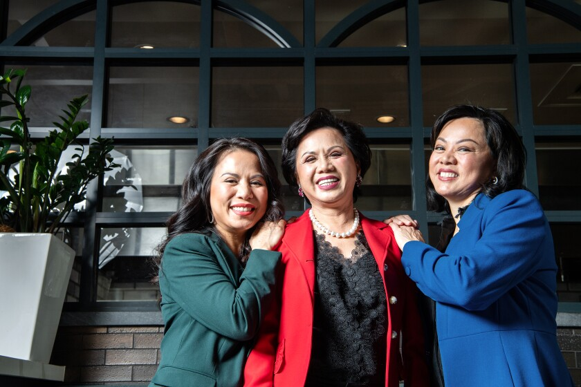 Diane Dang, center, and daughters Chau Haller, left, and Lisa Vo in one of their family's restaurants, Brodard