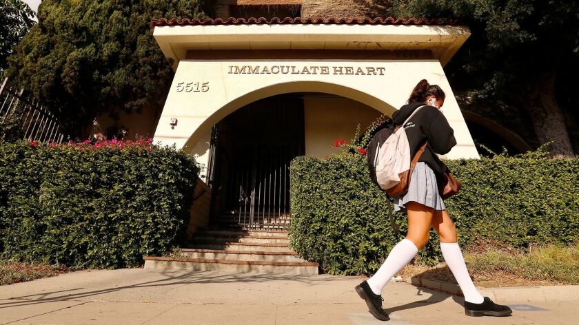 Students depart the campus at Immaculate Heart High School in the Hollywood Hills.