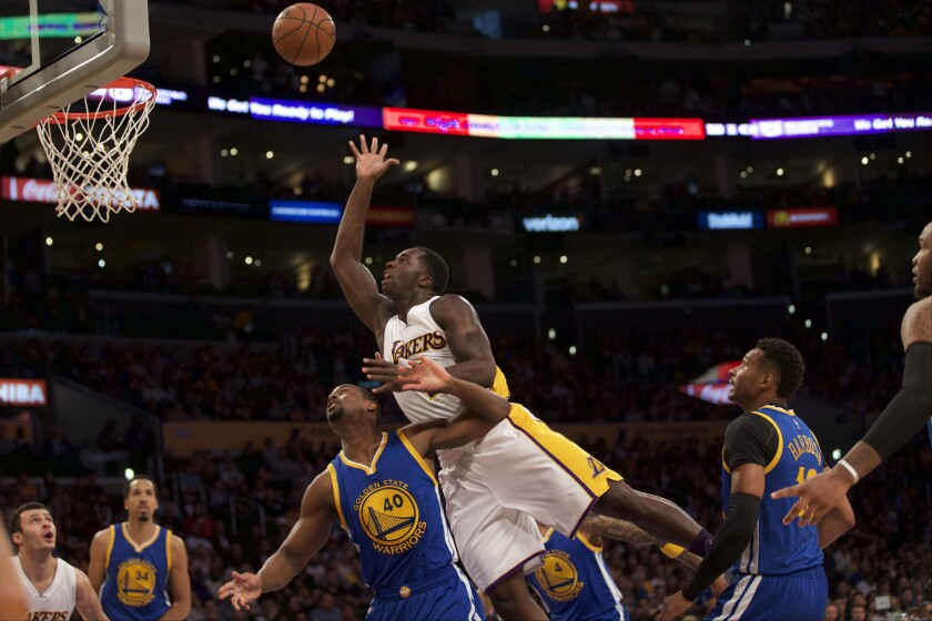 Lakers forward Brandon Bass puts up a shot against the Warriors during a game on March 6 at Staples Center. Randle finished with 12 points and 14 rebounds.