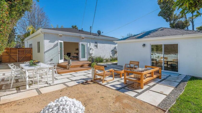 The updated bungalow features a newly built 400-square-foot accessory dwelling unit.