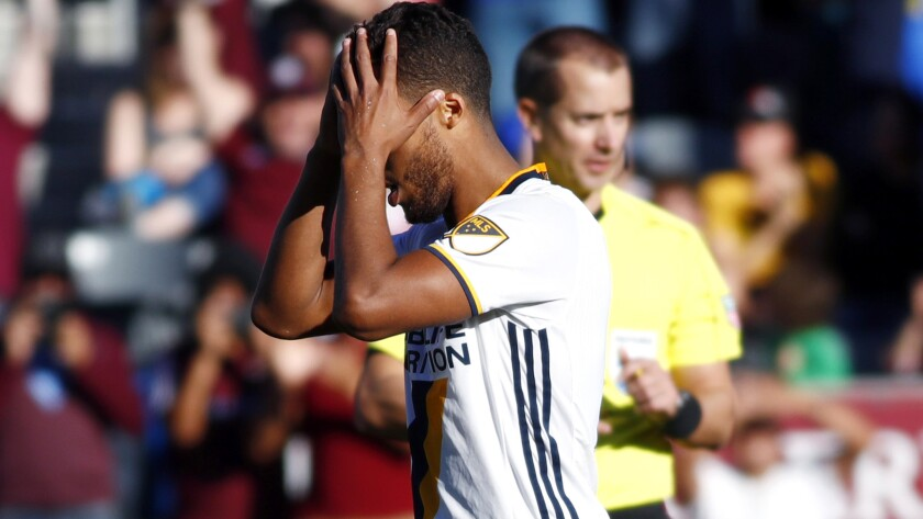 Galaxy forward Giovani dos Santos reacts after his kick went over the goal in the shootout against the Colorado Rapids.