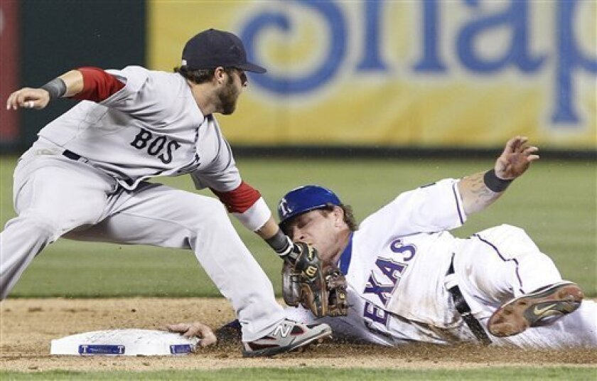Texas Rangers Josh Hamilton, right, steals second base against Boston Red Sox second baseman Dustin Pedroia during the third inning of a baseball game in Arlington, Texas, Saturday, April 2, 2011. (AP Photo/LM Otero)