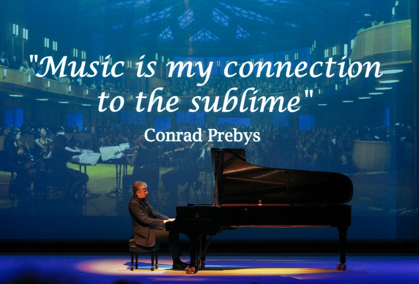Jean-Yves Thibaudet performs at the gala opening concert on April 5, 2019, of the La Jolla Music Society's new $82 million Conrad Prebys Performing Arts Center. In the background is a screen projecting a quote from founding donor Conrad Prebys, who died of cancer in July of 2016.