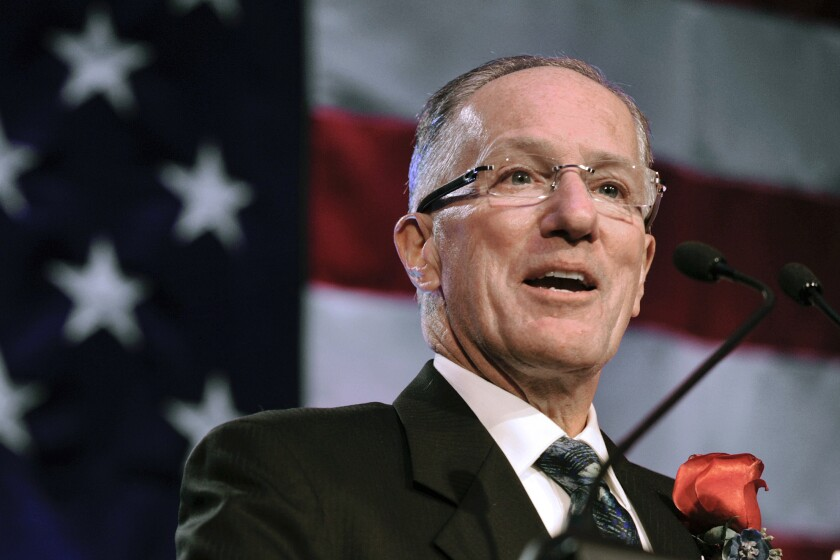 Mike Emrick speaks after being inducted into the U.S. Hockey Hall of Fame in 2011.