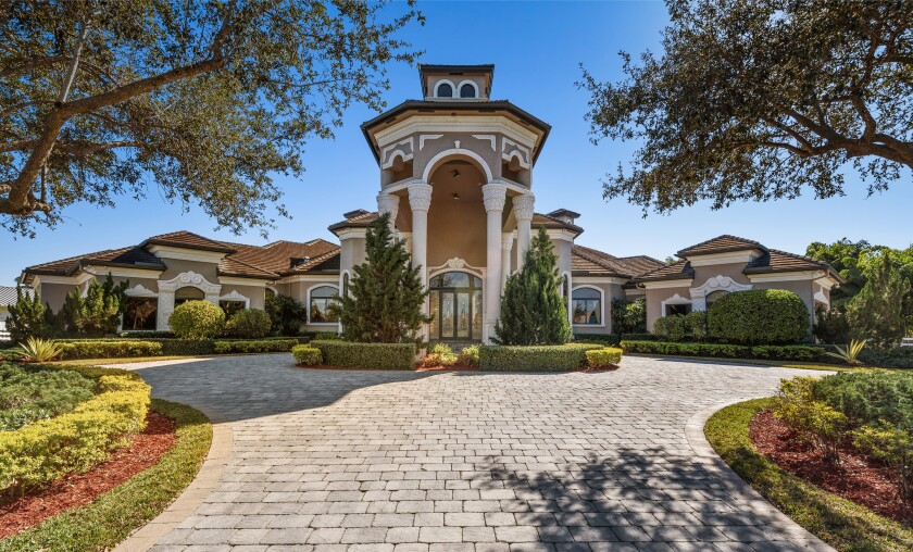 The 2.3-acre estate holds a main home, guesthouse and resort-style backyard with a swimming pool and spa.