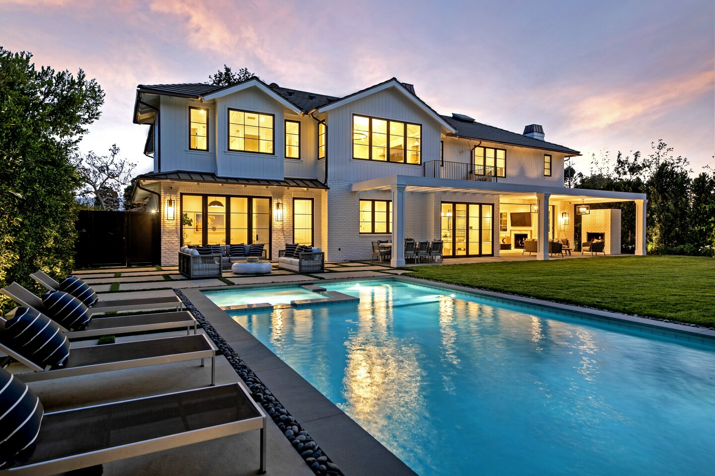 The brand new build sits on a third of an acre, fitting seven bedrooms and 8.5 bathrooms into 9,000 square $14 million - Pacific Palisades Luxury real estate developer Fred Magid took bronze last month, selling a brand new traditional-style estate for $14 million.Perched on a third of an acre about a mile from the ocean, the home fits seven bedrooms and 8.5 bathrooms into 9,000 square feet, including an owner's suite under vaulted ceilings that expands to a private balcony. Down below, a covered patio with a whitewashed brick fireplace leads to a grassy yard with a pool.James Harris and David Parnes of the Agency held the listing. Fredrik Eklund of Douglas Elliman represented the buyer.feet.