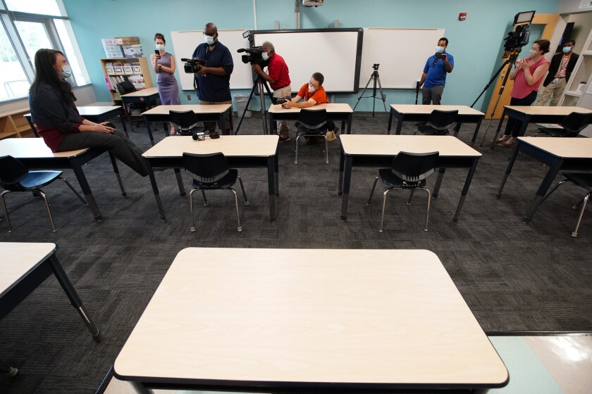 Principal Susan Stevens talks to the media during a demonstration of a socially-distanced classroom at A.J. Whittenberg Elementary School of Engineering Monday, July 20, 2020, in Greenville, S.C. (AP Photo/Chris Carlson)