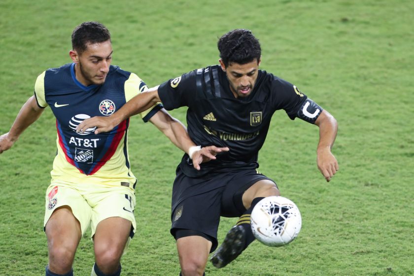 Club América's Sebastian Caceres, left, and LAFC's Carlos Vela battle for control of the ball.