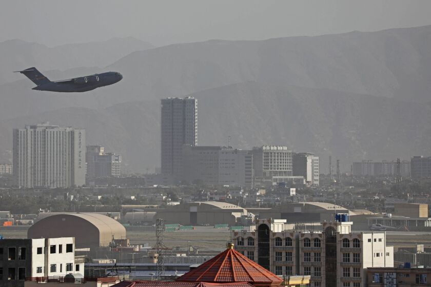 A U.S. plane flies above Kabul.