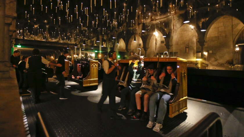 Candlesticks float and hover above the riders aboard Harry Potter and the Forbidden Journey in the Wizarding World of Harry Potter at Universal Studios Hollywood.