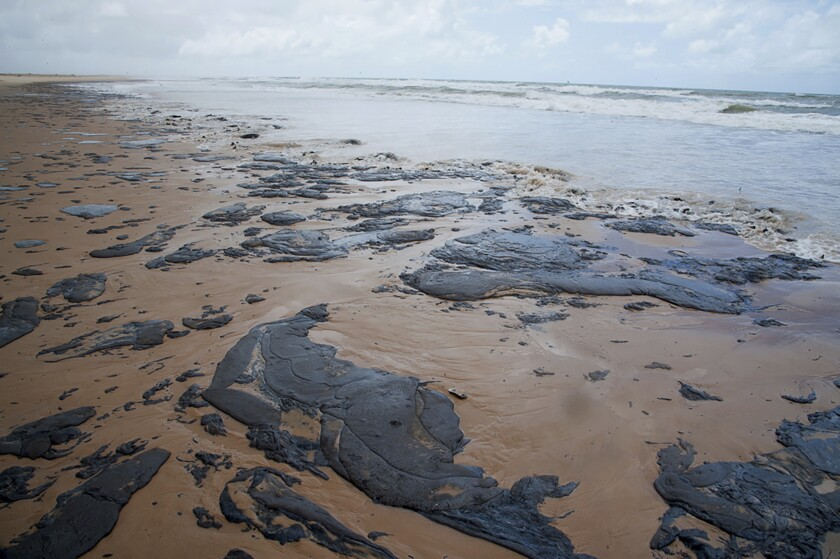 FILE - In this Sept. 25, 2019 file photo released by the Sergipe state government, oil covers the beach in Sergipe state, Brazil. Oil has been washing up on Brazilian beaches for two months, with authorities saying it's one of Brazil's worst-ever environmental disasters. (Sergipe State Government via AP, File)
