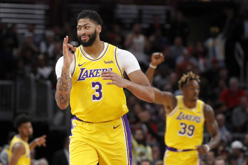 Lakers' Anthony Davis (3) celebrates a three-point basket during the second half against the Chicago Bulls on Tuesday in Chicago. The Lakers won 118-112.
