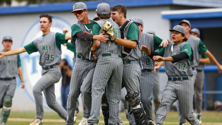 Poway reliever Dylan Moran (center) is embraced by Robby Williams (left) and catcher Deron Johnson (right) after the final out in the 10th inning against Eastlake.