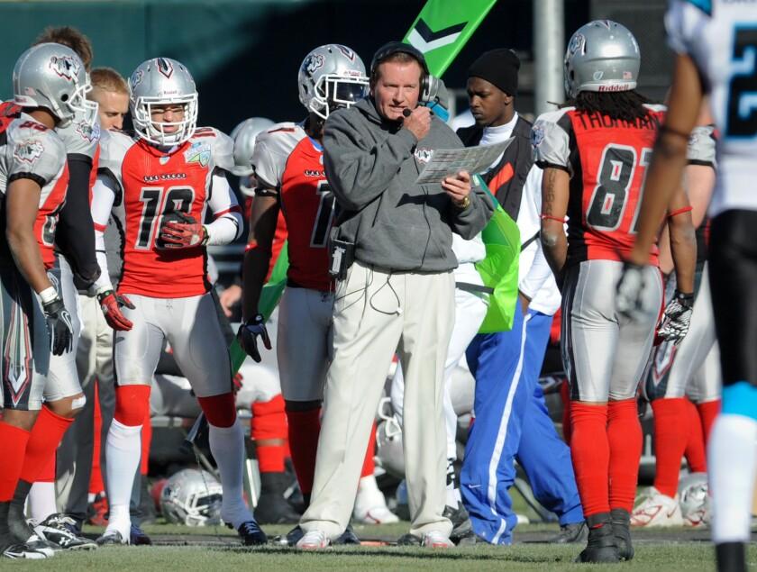 Las Vegas head coach Jim Fassel, center, looks on from the sideline.