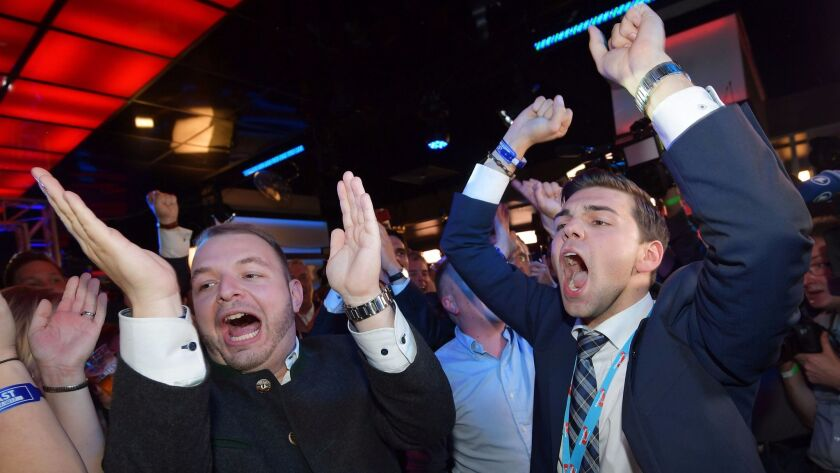 Supporters of the the German right-wing populist party Alternative for Germany celebrate at an elect