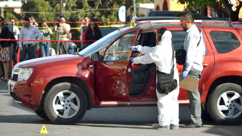 Mexican forensic experts inspect journalist Miroslava Breach's vehicle after she was killed by unknown gunmen Thursday morning after leaving her house in Chihuahua City, Mexico. (El Diario Chihuahua/ HANDOUT / EPA)