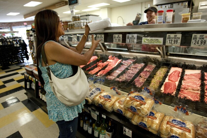 Danette Prsha from Bay Park picks up a couple of pounds of babyback ribs from Siesel's Meat for dinner.